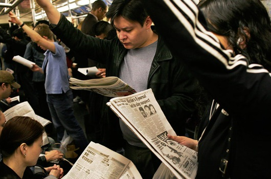 NYC_subway_riders_with_their_newspapers